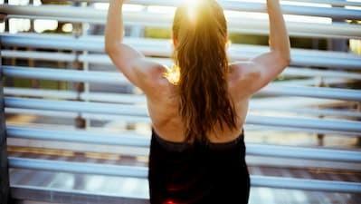 Woman leans against railings