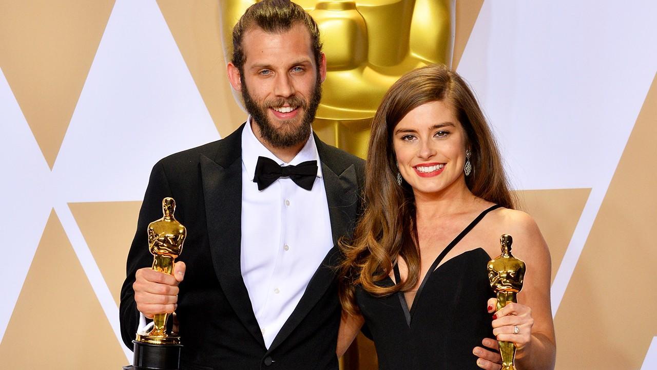 Rachel Shenton and Chris Overton holding Oscar statues