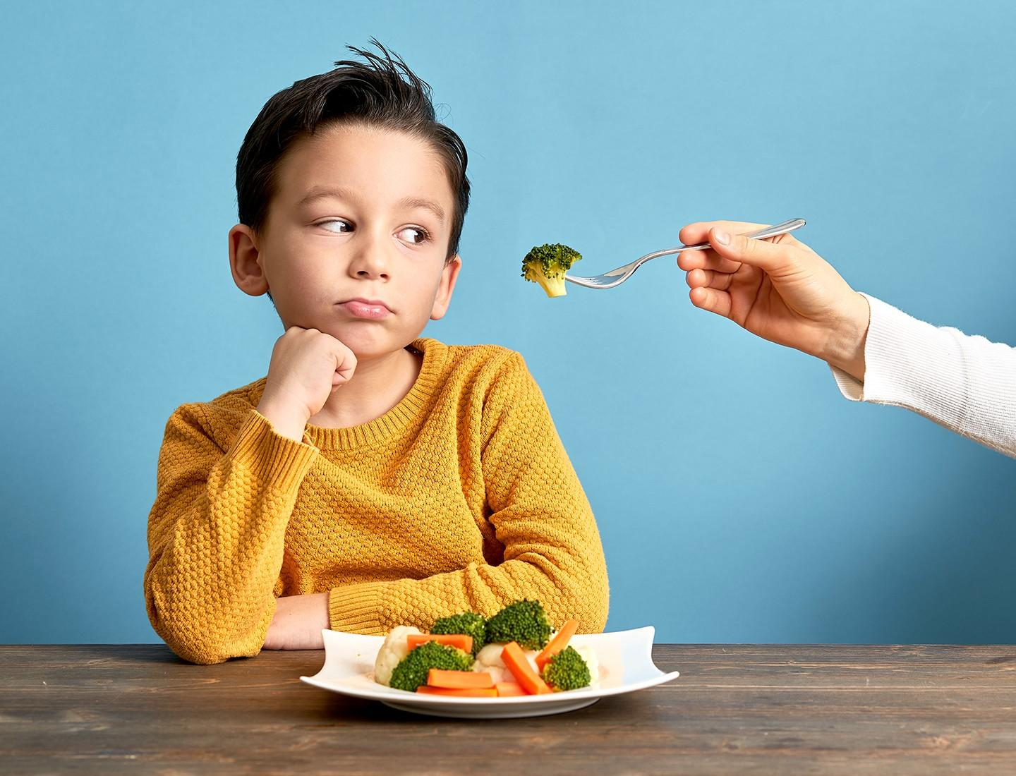 boy refusing to eat vegetables