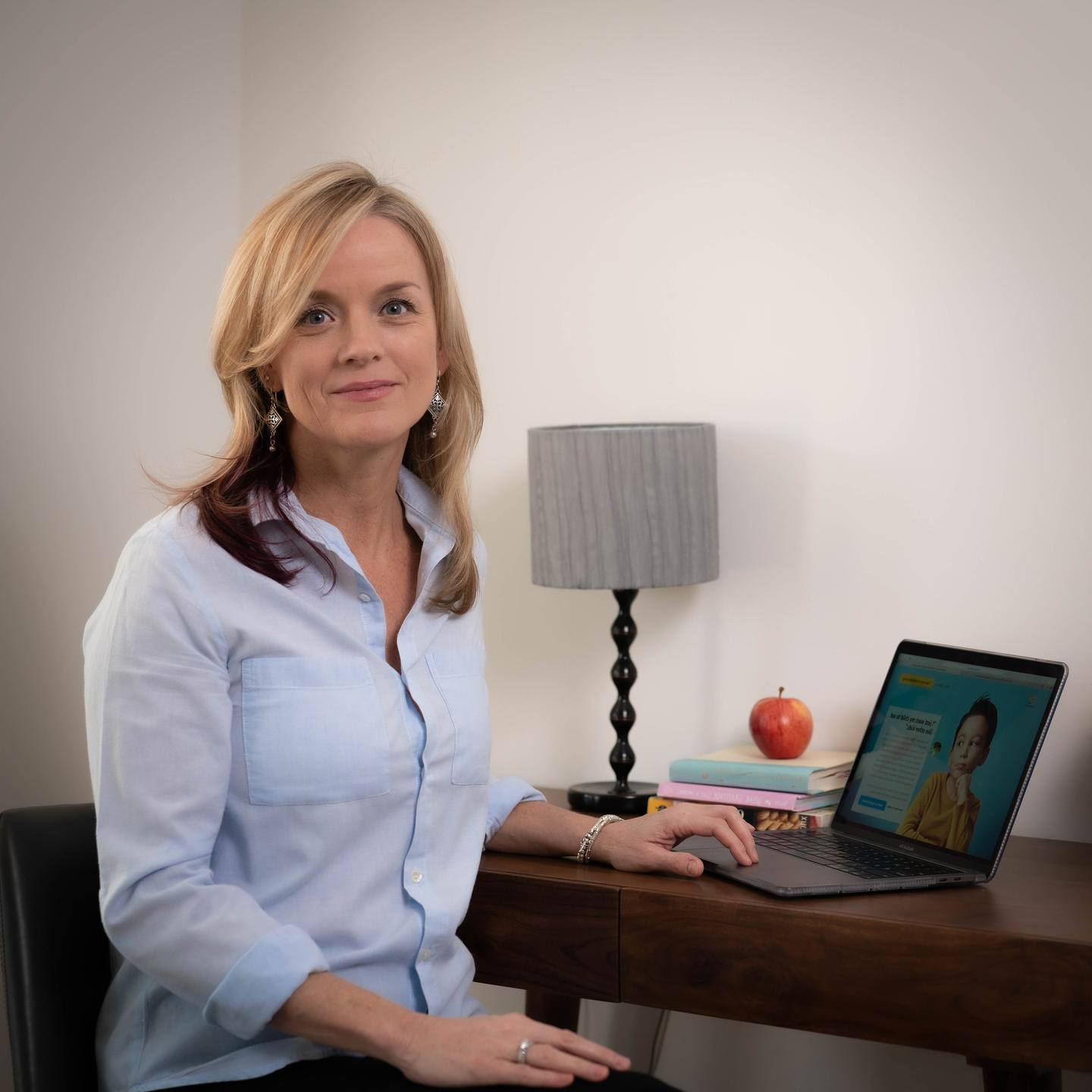 Nicola Pratt Director of FeedingPlus Inc at her desk
