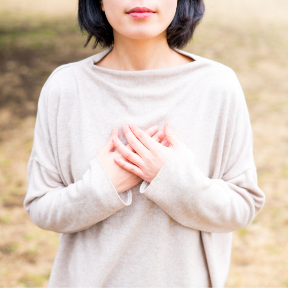 Woman with Hands over Heart