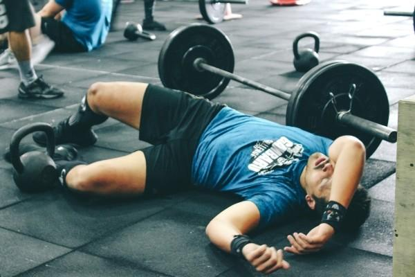 man exhausted from barbell exercise