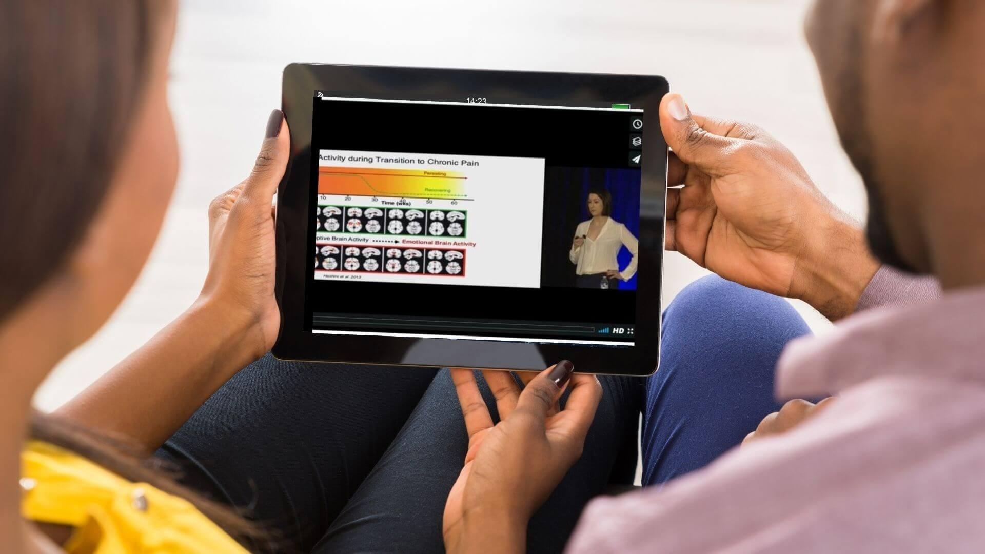 woman man holding ipad watching video