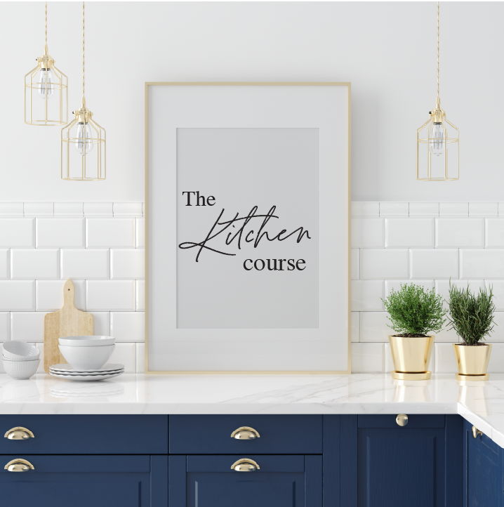 A framed image of the words The Kitchen Course on a kitchen counter.