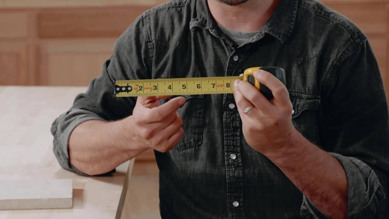 Construction teacher teaching tape measure