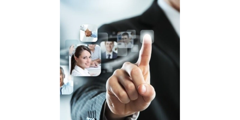 Finger of Human Resource Leader selecting the right people in a screen through Human Resources support and training programs.