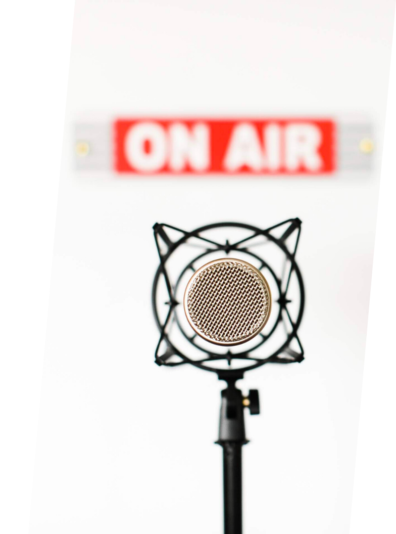 Podcast Microphone with on air sign on the wall