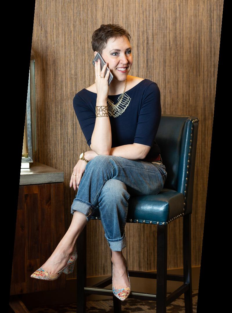 Penny Casselman sitting talking on iphone