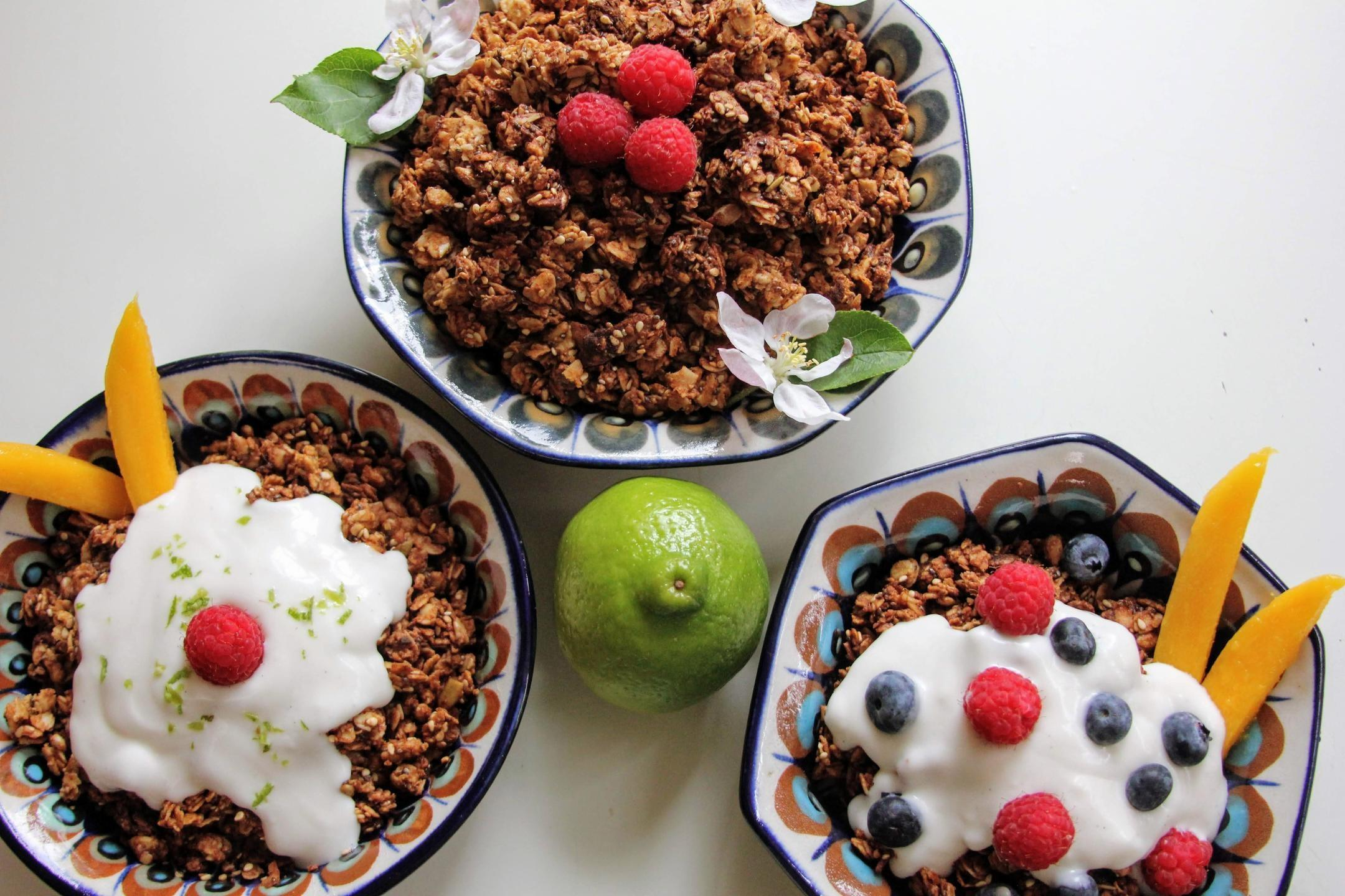 Vegan High-Protein Nut-Free Granola in 3 bowls with vegan yogurt and fruit toppings