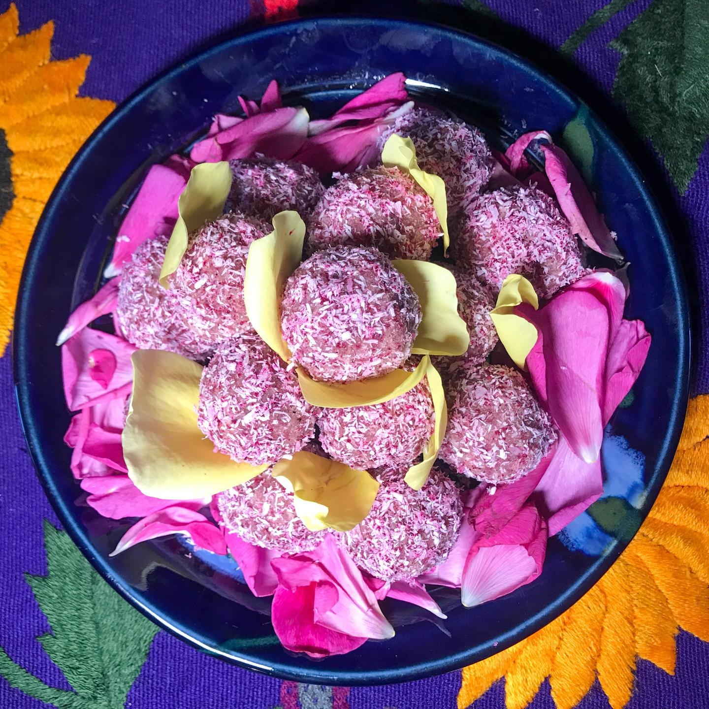 A pyramid of Coconut Ladoo: A Rose Infused Coconut Bliss Ball