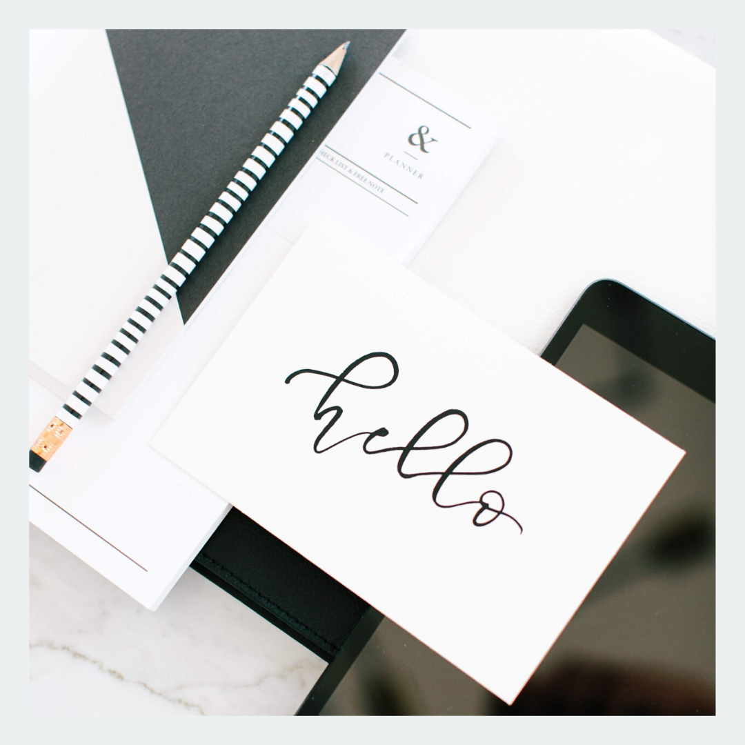 iPad Pencil Notebook and greeting card that says hello