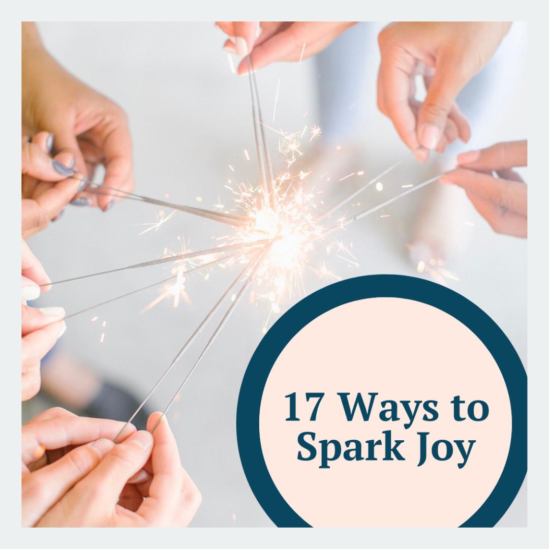 Five hands holding lit sparklers