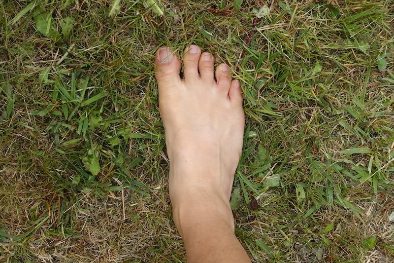 barefoot feet on grass