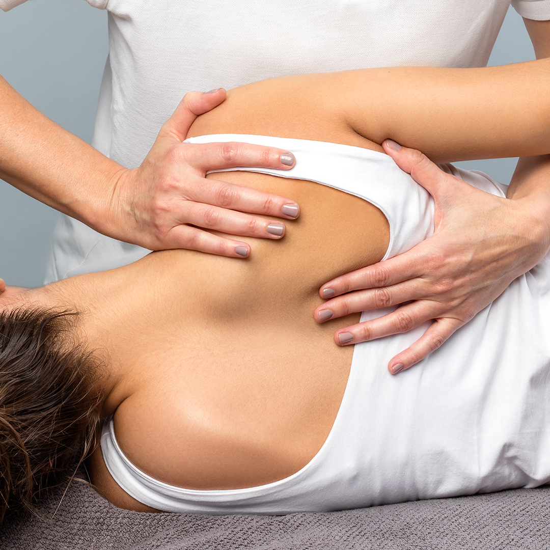 Chiropractic Care Services in Port Credit Mississauga, ON - pureBalance Wellness Cancer Care - woman getting chiropractic adjustment