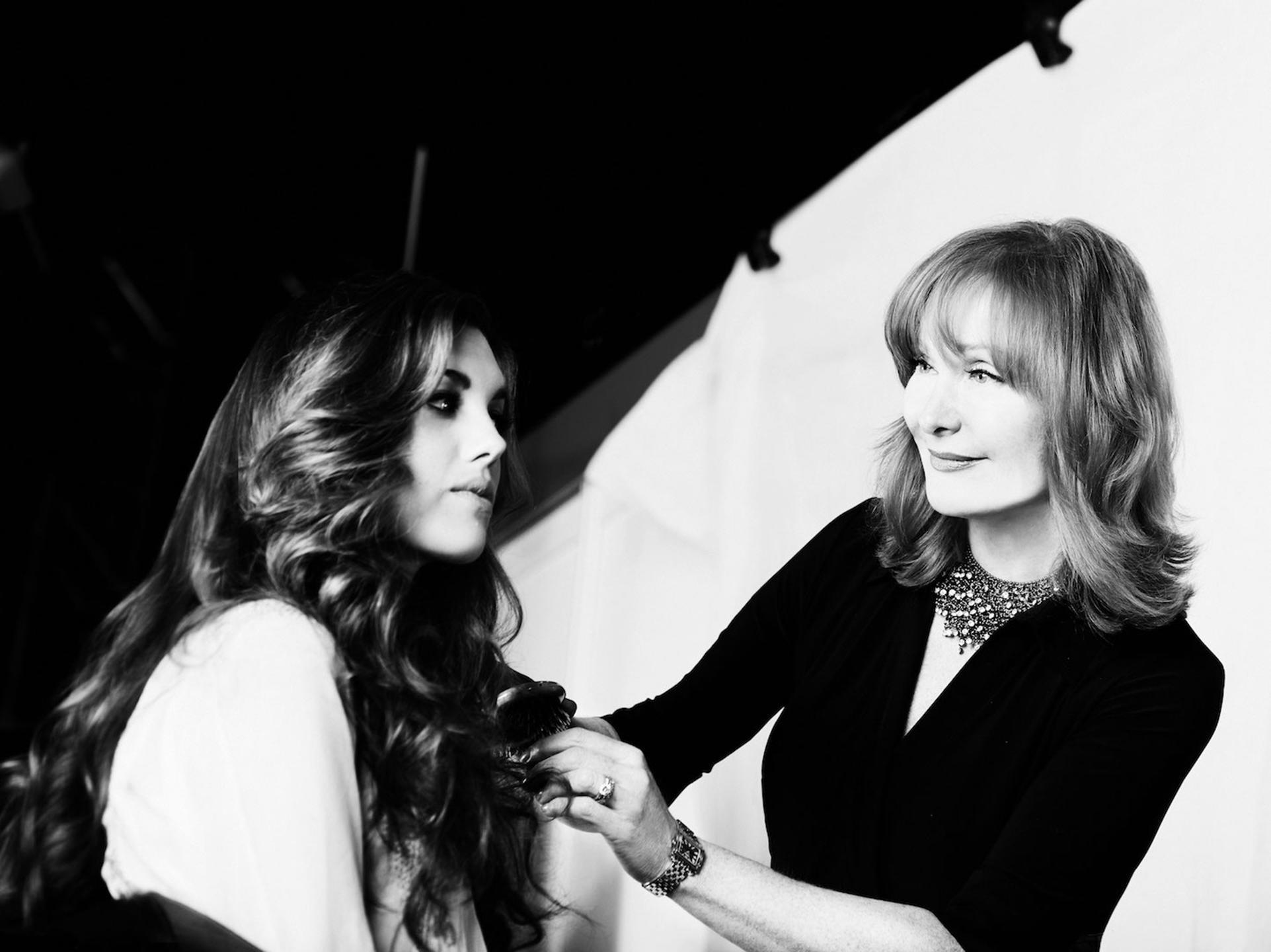 Vivienne Mackinder doing hair on model at photoshoot