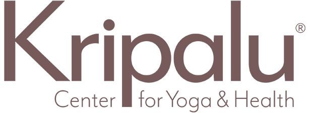 Brown text that says Kirpalu Center for Yoga & Health