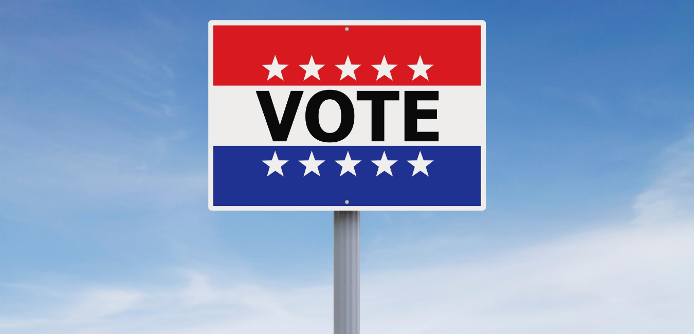 Red white and blue sign that says VOTE