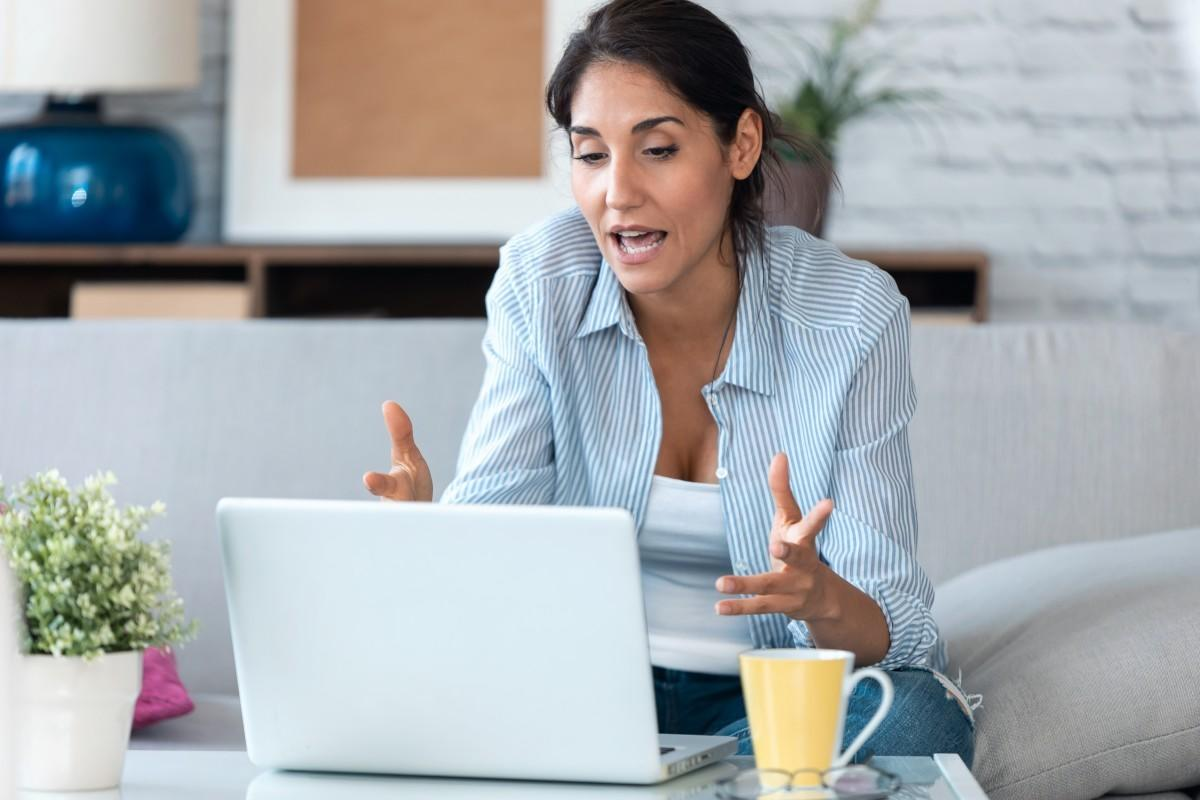 woman talking on computer during live workshop