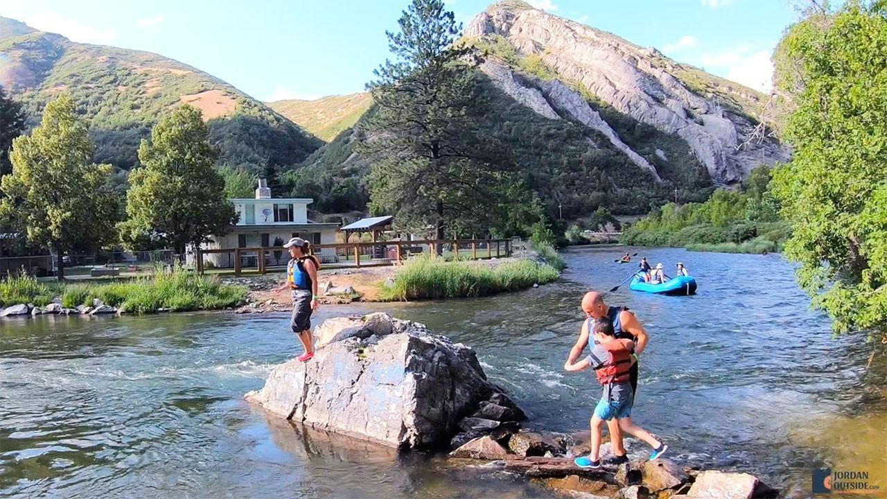 Walking over rocks on the Provo River
