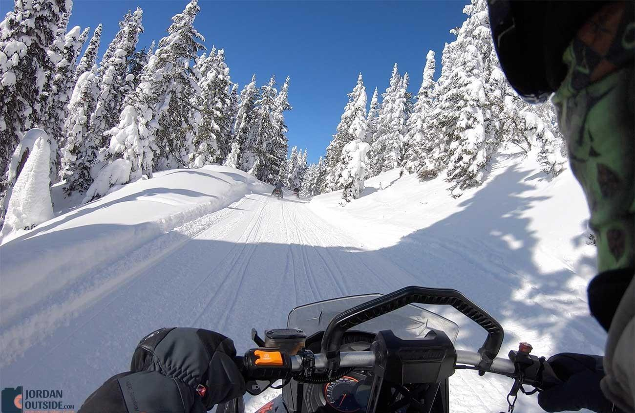 Snowmobiling up Mt Two Top