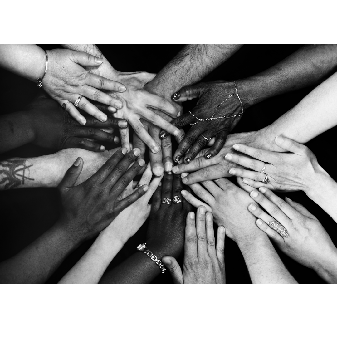 community of hands reaching together