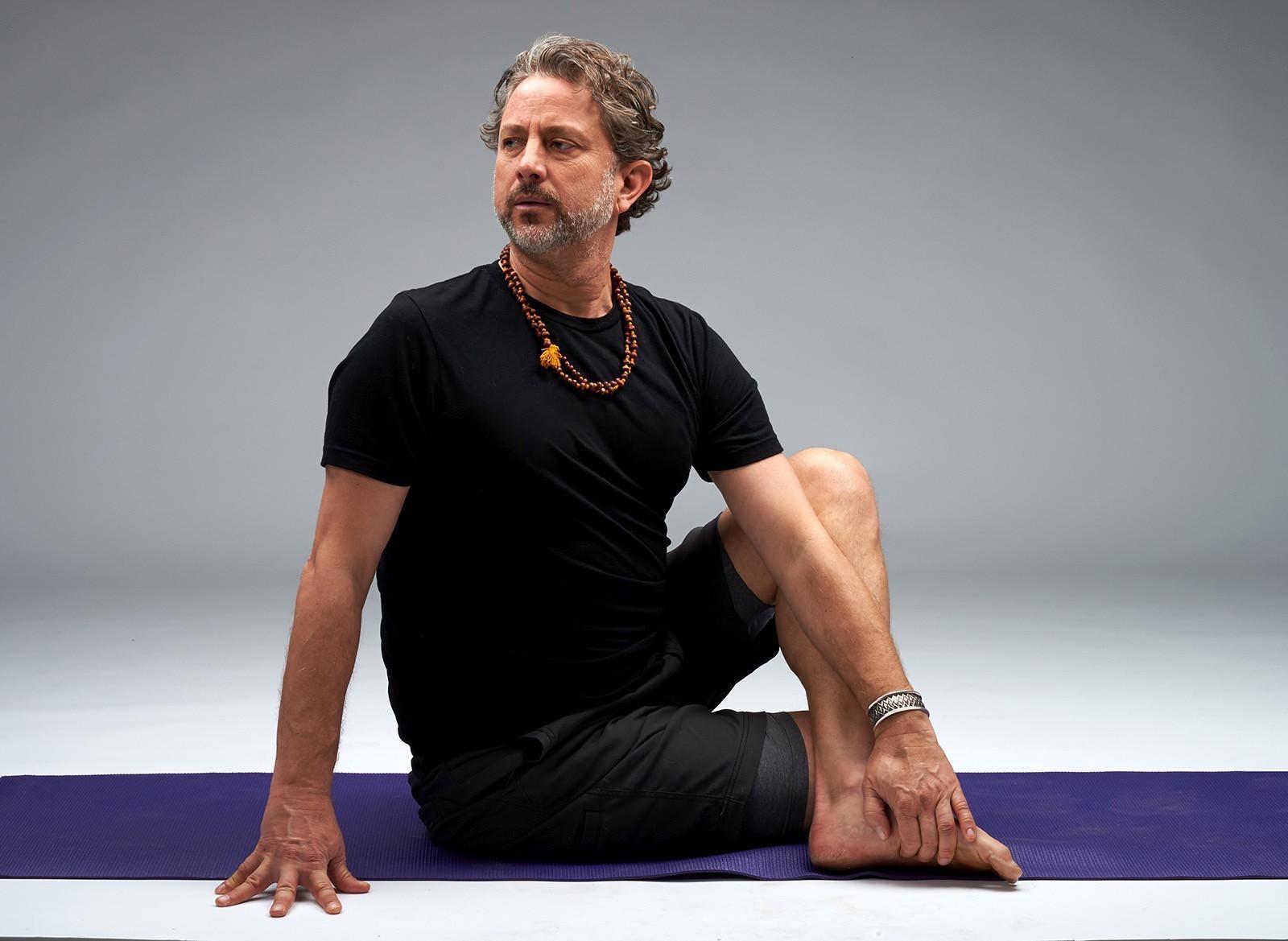 Brad Wetzler male yoga teacher on yoga mat