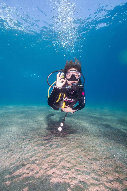 Scuba diver giving the OK sign