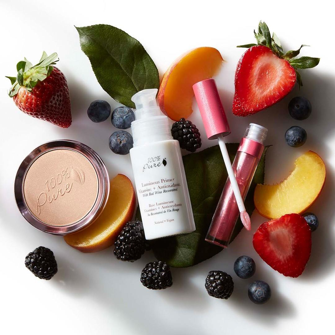 100% pure natural makeup products surrounded by fresh fruits.  Natural, clean, toxic-free, cruelty-free makeup & beauty products