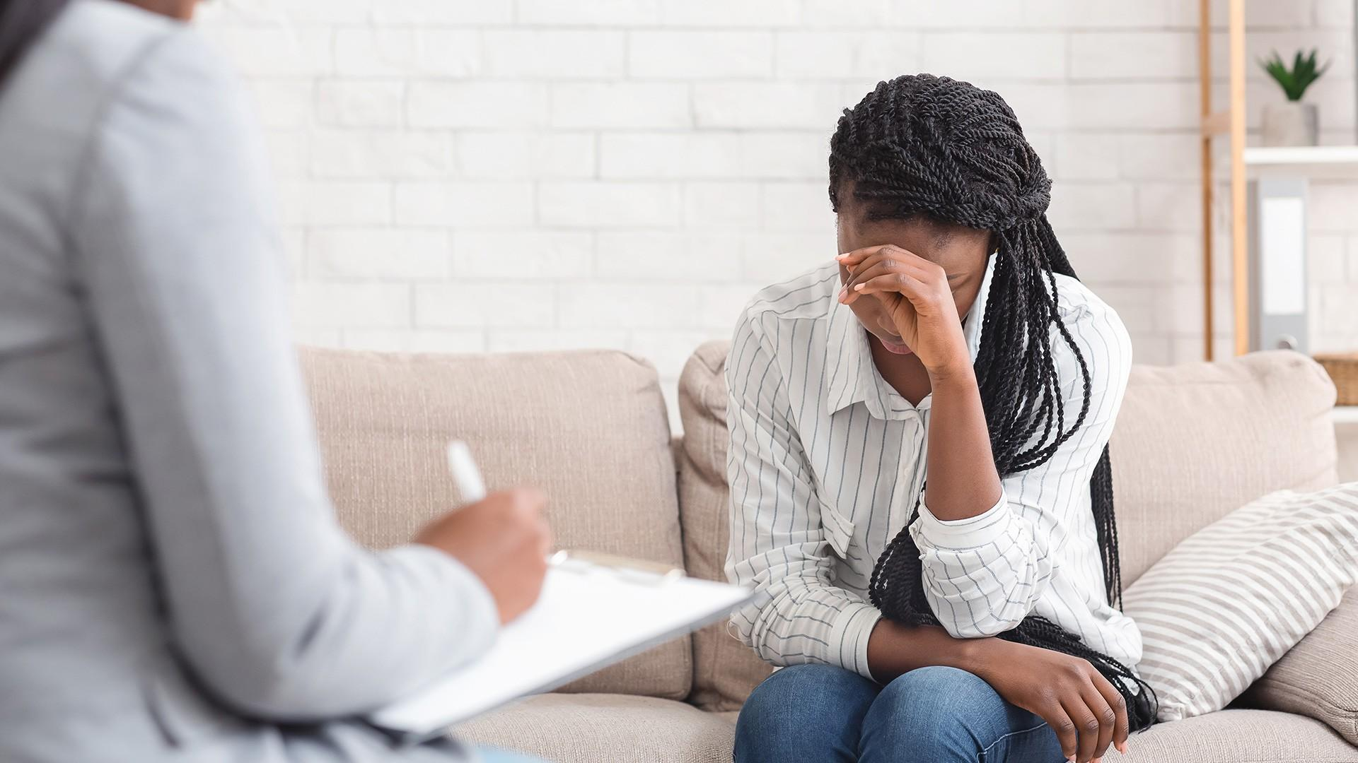 depressed african american female receiving counselling