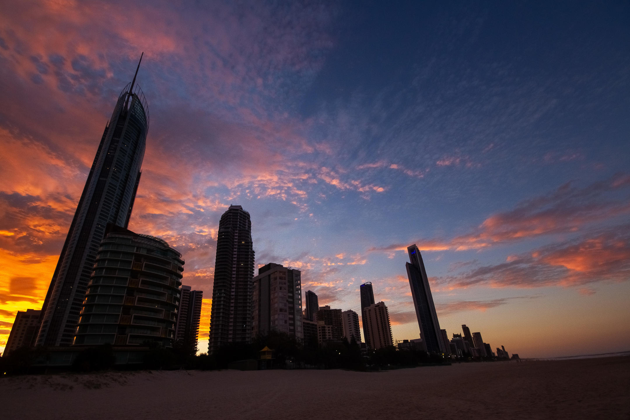 Looking back towards the sky scrapers of surfers paradise as the sun sets