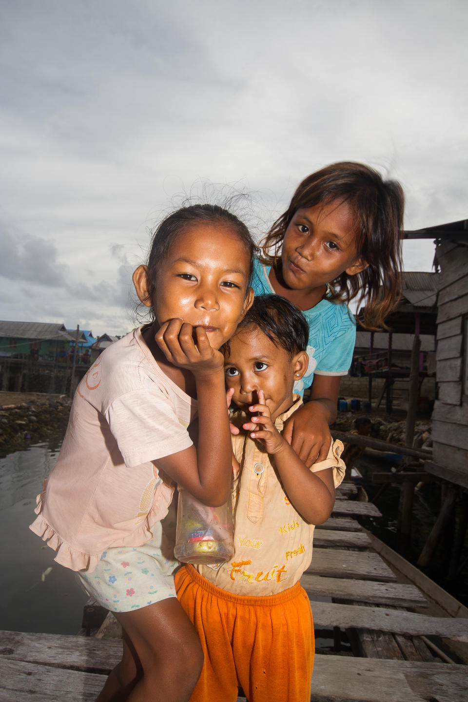 Three local kids posing for the camera