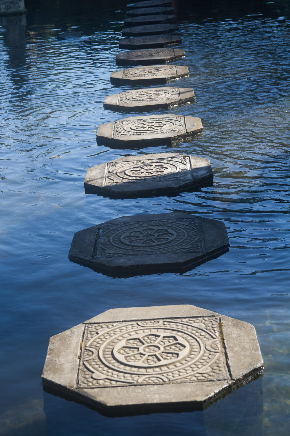 Balinese stepping stones across a pond