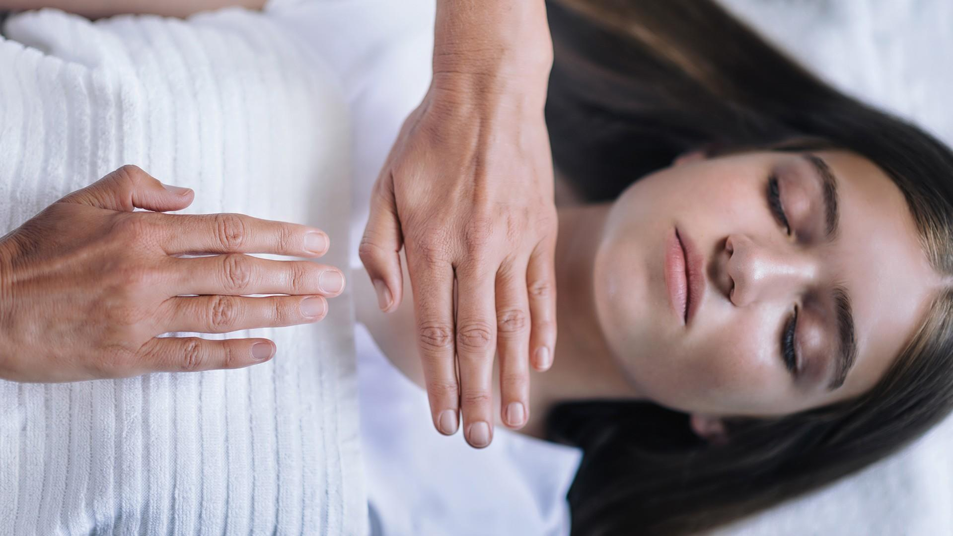 woman receiving energy healing treatment