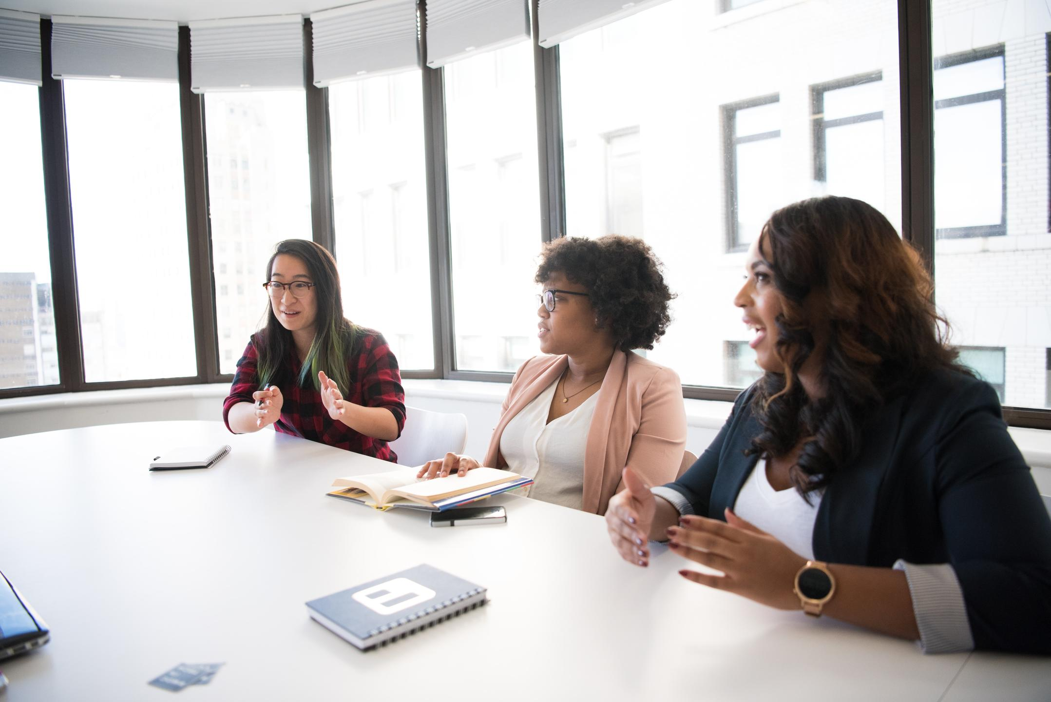 three women in a meeting in a boardroom