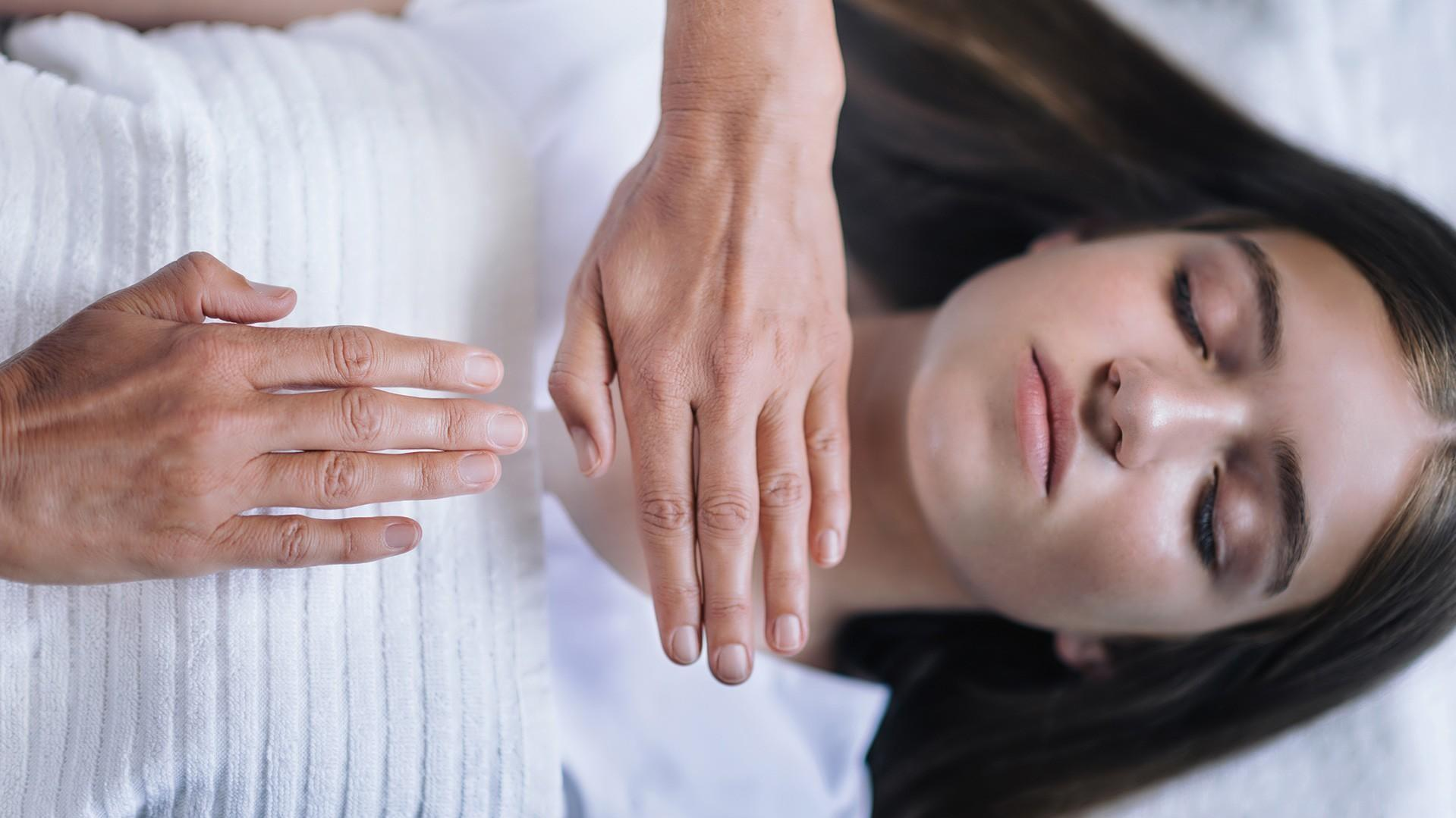 woman receiving energy healing- Reconnective Healing & The Reconnection  services available at pureBalance Wellness in Mississauga
