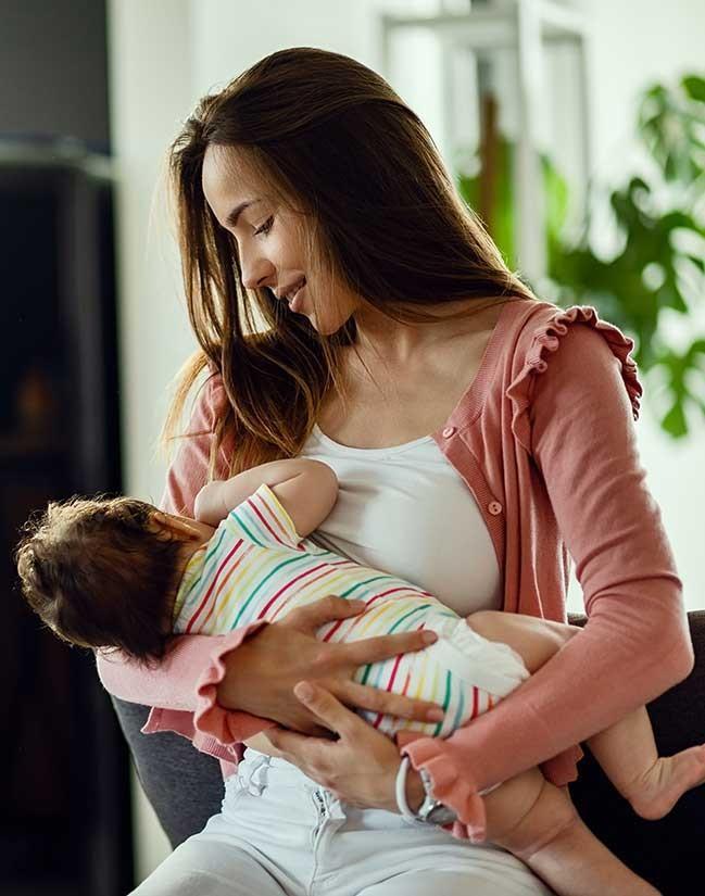 Breastfeeding Mother smiling