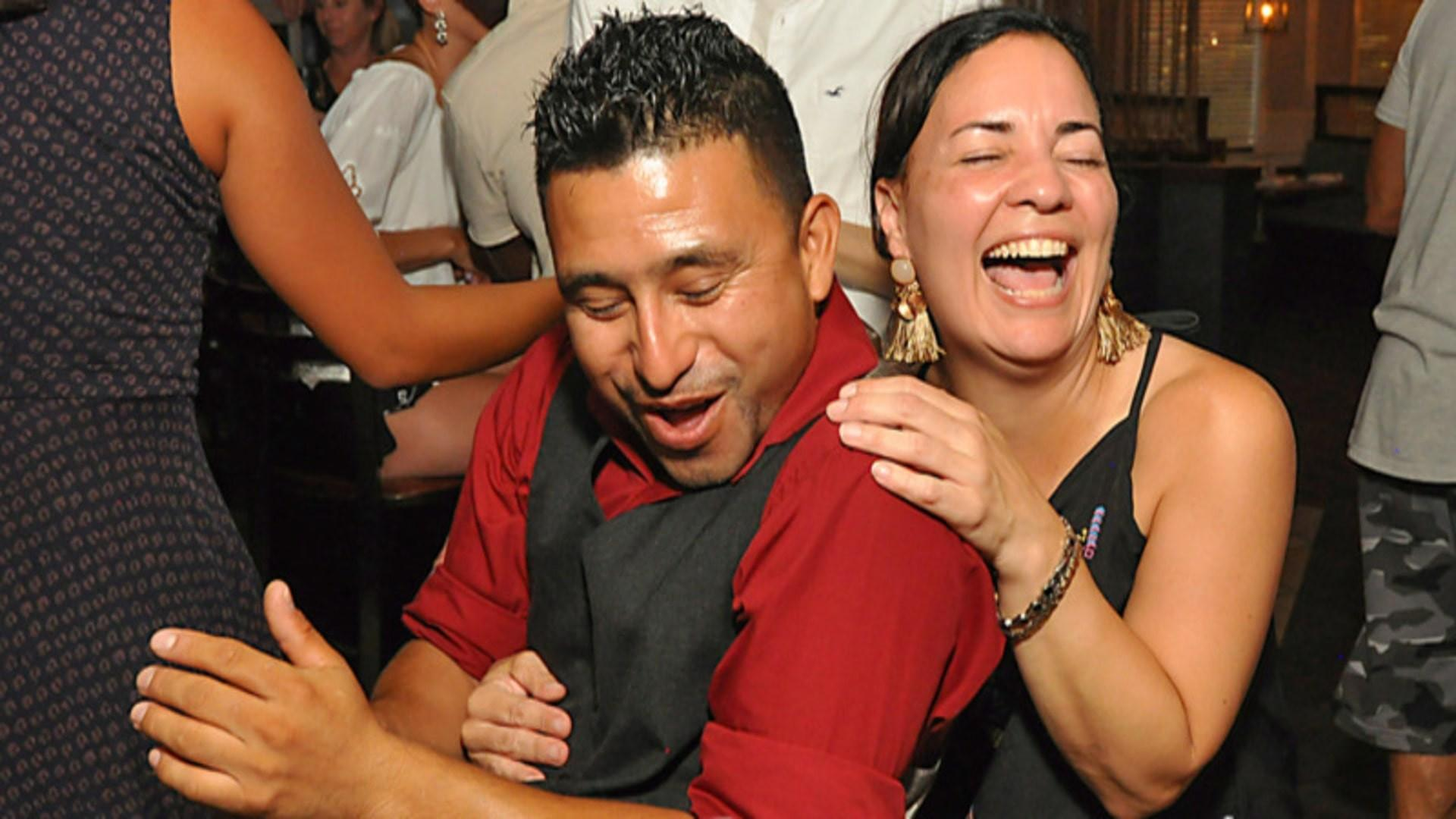 a happy couple latin dancing bachata