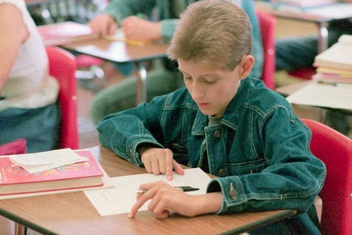 student sitting physics exam in nineties