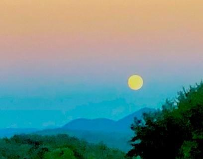 Full moon rising over the mountains, cycles of day and night reflected in the Wise Woman Tradition