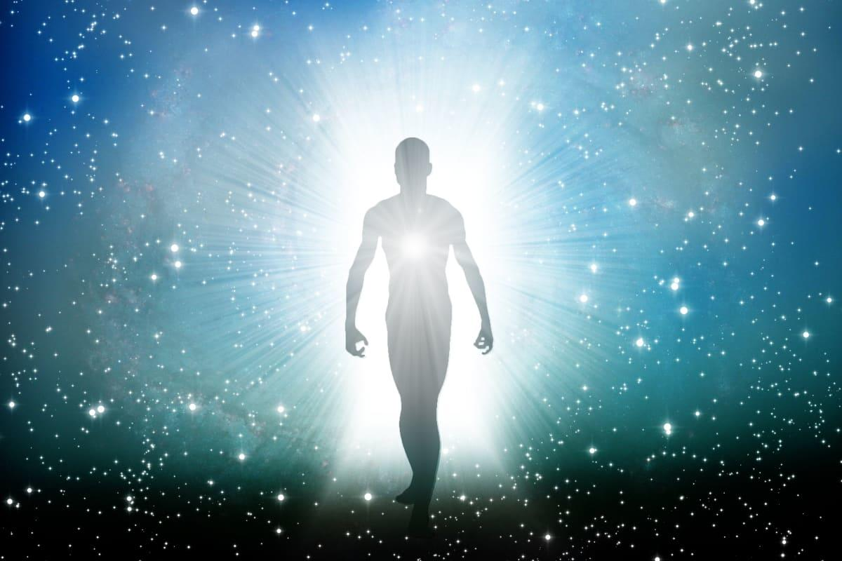 human figure stepping out of a galactic burst of light