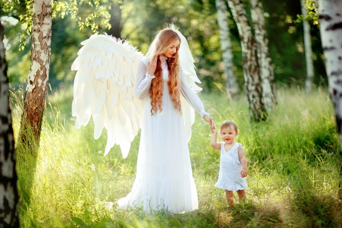beautiful angel guiding a small child