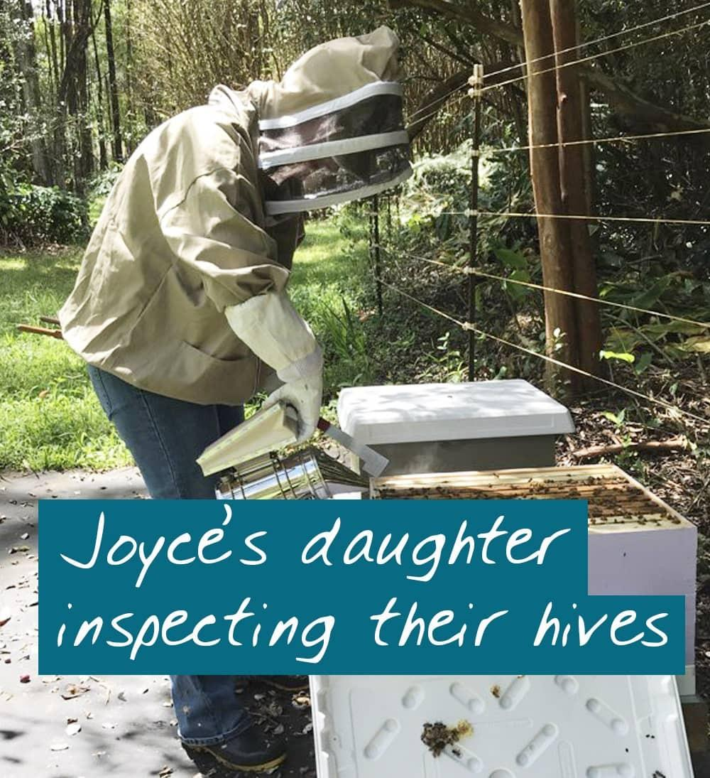 online beekeeping course student inspecting her hive