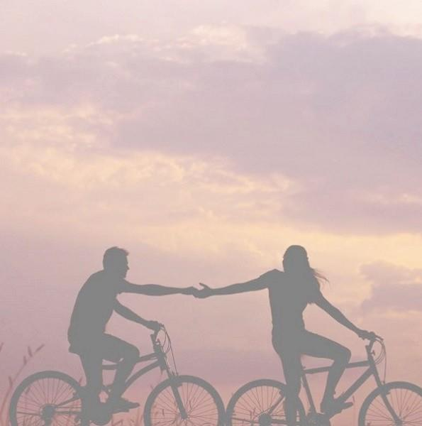 Healthy couple riding bikes together