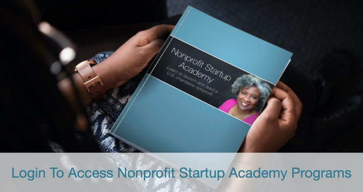 Hands holding Nonprofit Startup Academy book