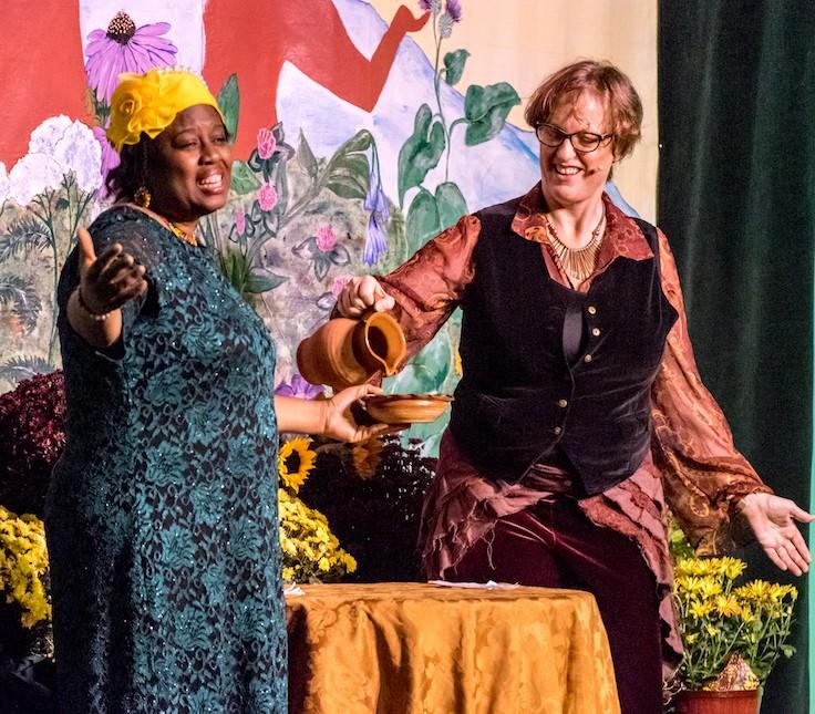Phyllis and Corinna pouring water into a bowl at Opening Ceremony of the Southeast Wise Women Herbal Conference