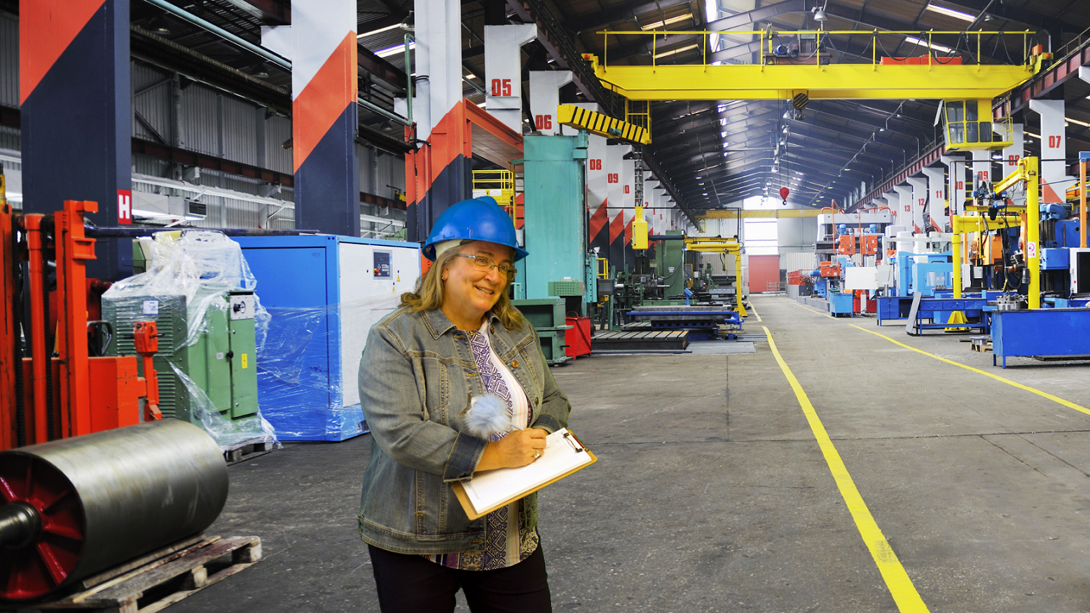 Diana with clipboard in factory