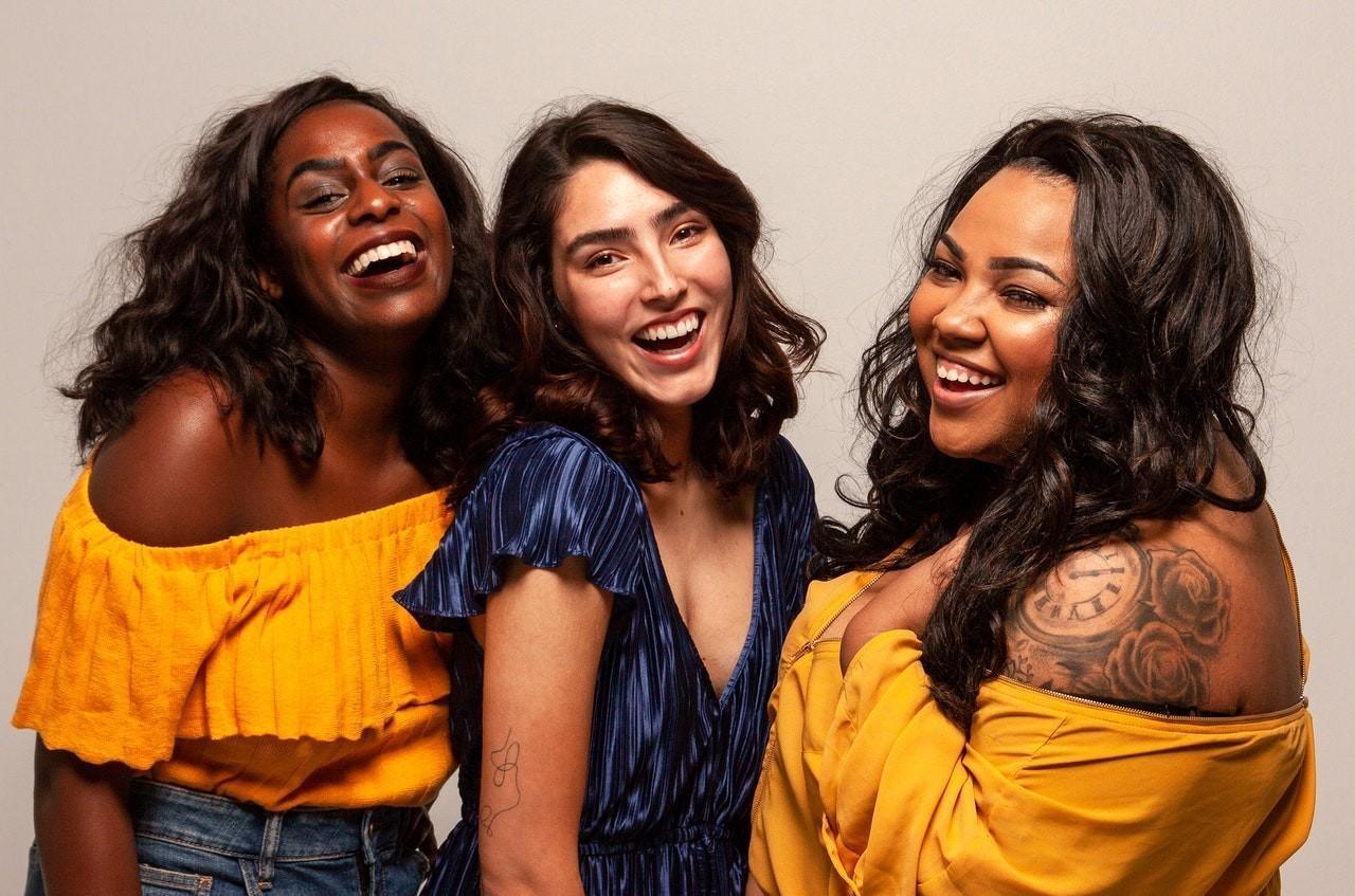 Happy women in the breakup support group