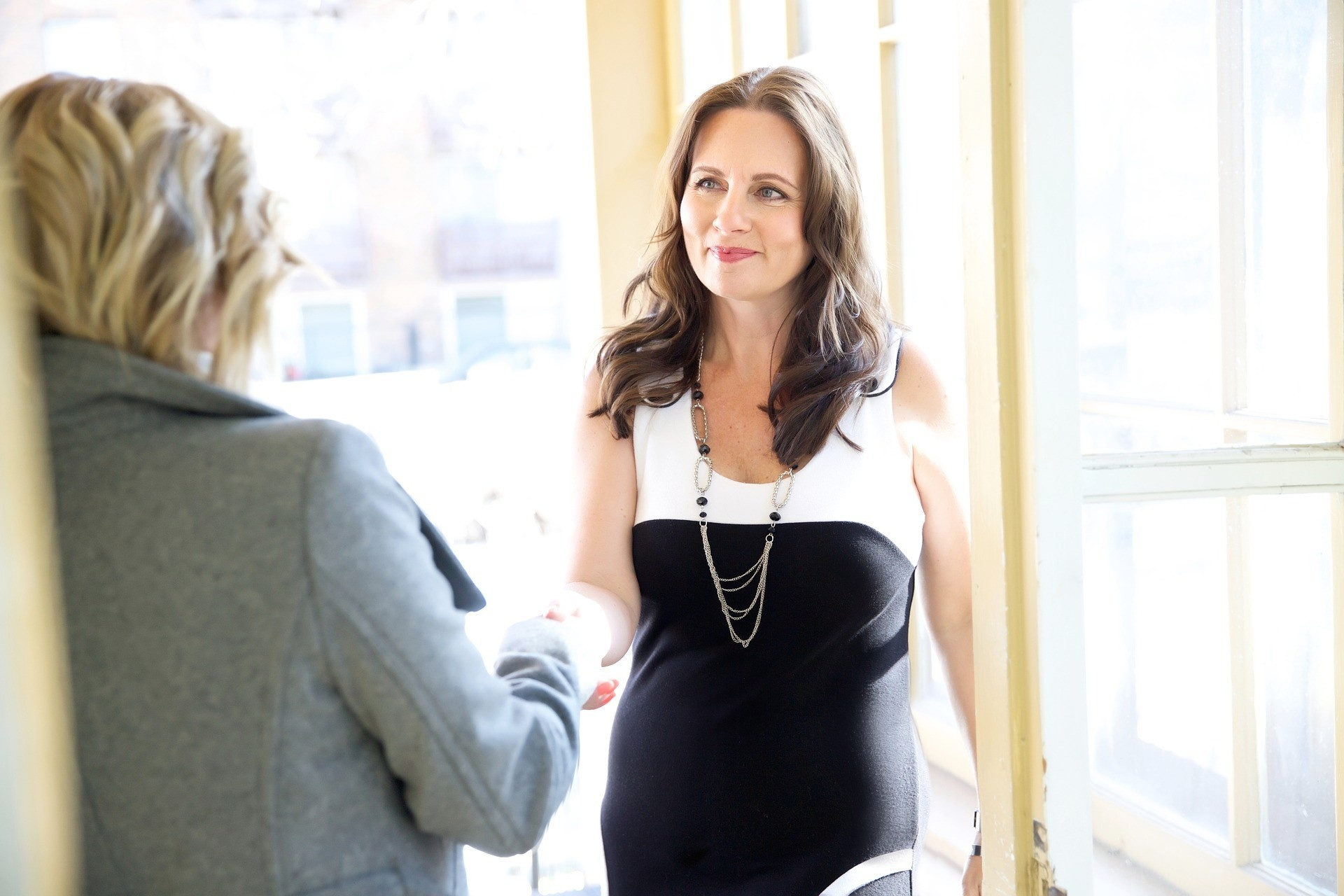 Woman gaining a new client