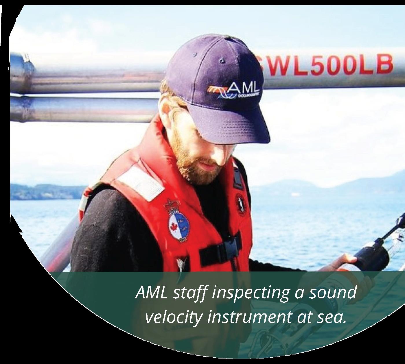 AML staff inspecting a sound velocity instrument at sea. Photo courtesy AML Oceanographic