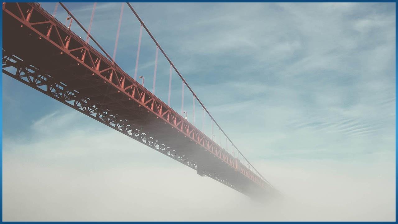 long bridge over cloudy skies